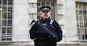 A police guard in London. Theresa May said Isis had given 'a renewed sense of purpose' to subversive